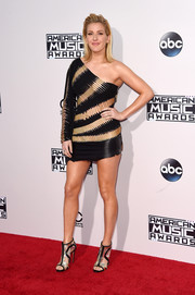 Ellie Goulding continued the black and gold motif with a pair of cutout booties.