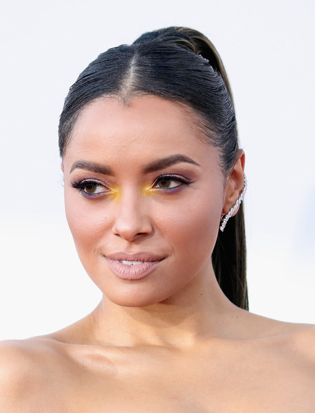 Kat Graham got creative with her beauty look, dabbing on some bright yellow on the inner corners of her eyes.