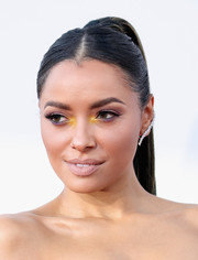 Kat Graham pulled her hair back away from her face into a tight, center-parted ponytail for the American Music Awards.