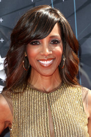 Shaun Robinson styled her hair with soft waves for the BET Awards.