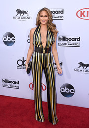Chrissy Teigen went for a sexy '70s vibe in a plunging, striped jumpsuit by Balmain during the Billboard Music Awards.