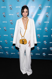 For a pop of color to her all-white outfit, Vanessa Hudgens accessorized with a mustard suede shoulder bag by Chloe.