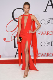 Natasha Poly brought major sex appeal to the CFDA Fashion Awards in a red Michael Kors gown with a deep-V cutout and a thigh-high slit.