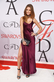 Josephine Skriver styled her gown with a pair of chain-embellished ankle-strap sandals.