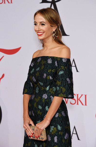 Harley Viera-Newton paired a gold glitter clutch with an off-the-shoulder frock for her CFDA Fashion Awards look.