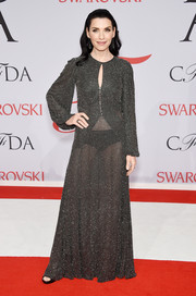 Julianna Margulies' long-sleeve gray Michael Kors gown at the CFDA Fashion Awards looked conservative at first, until you see that flash of black underwear.