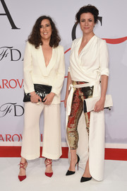 Garance Dore teamed her flashy trousers with an equally fab high-low white coat.