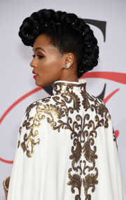 Janelle Monae attended the CFDA Fashion Awards rocking a super-cool braided fauxhawk.