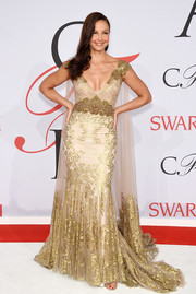 Ashley Judd was a gilded queen at the CFDA Fashion Awards in a gold Badgley Mischka gown with a watteau train.