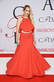Jemima Kirke went for a flirty party look in a flared red crop-top by Rosie Assoulin during the CFDA Fashion Awards.
