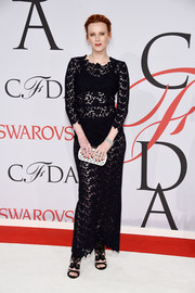 Karen Elson kept it classic (with a sexy twist) in a see-through black lace gown by Katie Ermilio at the CFDA Fashion Awards.