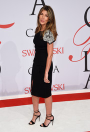 Nina Garcia chose a little black dress with bedazzled sleeves for her CFDA Fashion Awards look.