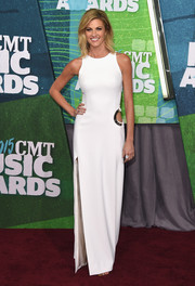 Erin Andrews went for modern minimalism in a sleeveless white cutout gown during the CMT Music Awards.
