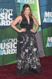Hillary Scott hovered between sweet and sultry in a Roberto Cavalli deep-V floral gown during the CMT Music Awards.