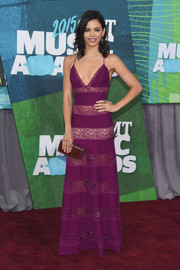 Jenna Dewan-Tatum made an alluring appearance at the CMT Music Awards in a purple lace-striped slip dress by Zuhair Murad.