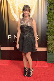 Opting for a mini instead of a gown, Rashida Jones donned this bird-embroidered, sheer-panel dress by Valentino for the Creative Arts Emmy Awards.