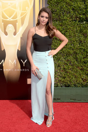 Nina Dobrev polished off her look with a silver tube clutch by Ferragamo.