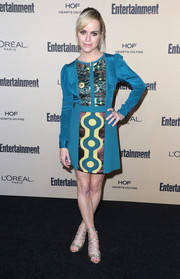 Taryn Manning contrasted her retro dress with modern gold lace-up sandals.
