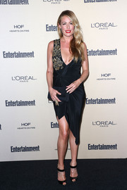 Cat Deeley oozed sex appeal in a slinky asymmetrical wrap dress by Marchesa at the Entertainment Weekly pre-Emmy party.