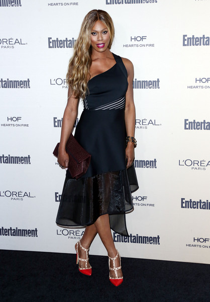 Laverne Cox chose an angular maroon leather clutch to complete her look.
