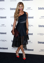 Laverne Cox went the modern-glam route in an asymmetrical navy dress by David Koma, featuring striped panels and a sheer hem, during the Entertainment Weekly pre-Emmy party.