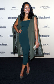 Garcelle Beauvais styled her dress with a chic sleeveless cape coat.
