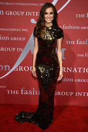 Allison Williams totally mesmerized in a figure-skimming gold sequin gown by Lanvin at the Night of Stars Gala.