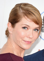 Katie Aselton styled her hair into a classic chignon with side-swept bangs for the Film Independent Spirit Awards.