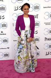 Ava DuVernay topped off her lovely gown with a purple cropped jacket.