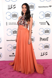 Olivia Munn looked peppy at the Film Independent Spirit Awards in a Prabal Gurung halter gown featuring a sequined bodice, peekaboo detailing, and a flowy coral skirt.