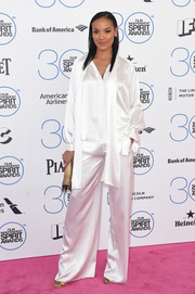 Selita Ebanks completed her bedroom-chic look with a white silk button-down.