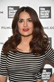 Salma Hayek wore red lipstick for a splash of color to her monochrome look.