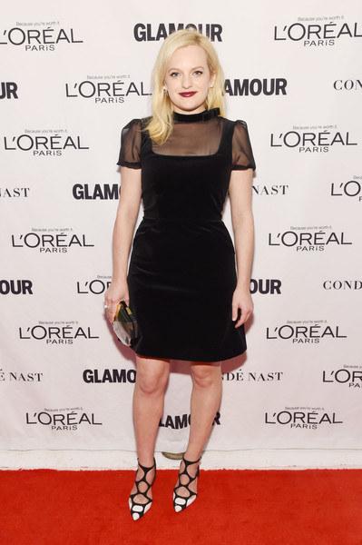 Elisabeth Moss contrasted her classic dress with ultra-modern black-and-white cage pumps.