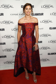 Alex Morgan made an ultra-elegant statement at the 2015 Glamour Women of the Year Awards in a red and purple floral off-the-shoulder dress.
