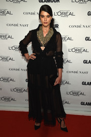 Crystal Renn flashed some skin in a sheer, ruffle-accented shirtdress at the Glamour Women of the Year Awards.