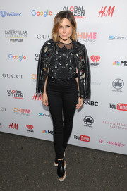 Sophia Bush teamed an embellished black leather jacket with a sheer-panel top, both by Coach, for the Global Citizen Festival.