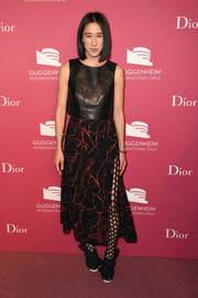 Eva Chen got majorly edgy in a high-slit abstract-print skirt teamed with a leather top and polka-dot tights at the Guggenheim International Gala pre-party.