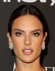 Alessandra Ambrosio stuck to her trademark center-parted style when she attended the InStyle and Warner Bros. Golden Globes party.