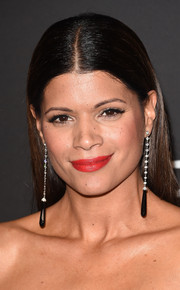 Andrea Navedo wore her hair tightly parted down the middle during the InStyle and Warner Bros. Golden Globes party.
