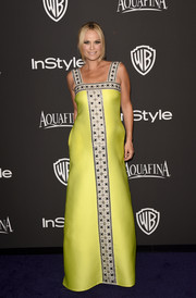 Molly Sims' embroidered neon-yellow Lisa Perry gown at the InStyle and Warner Bros. Golden Globes party had a Middle Eastern royalty feel to it.