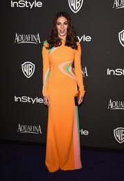 Moran Atias was hippie-glam at the InStyle and Warner Bros. Golden Globes party in a long-sleeve orange dress with pink and green swirl accents.