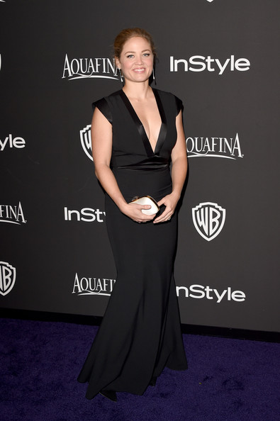 Erika Christensen was sexy yet classy in a black evening dress with a plunging neckline during the InStyle and Warner Bros. Golden Globes party.