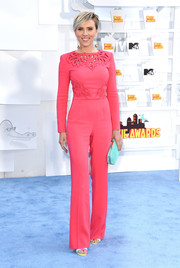 Scarlett Johansson was unafraid of color, pairing her pink outfit with a bright turquoise Roger Vivier clutch.