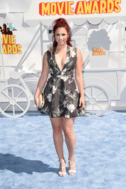 Jillian Rose Reed teamed her sizzling-hot dress with white strappy sandals by Izabella Rue for Shoedazzle.