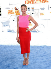 Brittany Snow paired her colorful dress with studded nude heels by Jerome C. Rousseau.