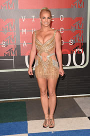 Britney Spears added more sparkle with a pair of bedazzled strappy sandals by Rene Caovilla.