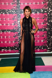 Chrissy Teigen got majorly sultry in this sheer black Marchesa halter gown for the MTV VMAs.