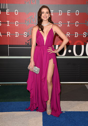 Greer Grammer flashed plenty of skin at the MTV VMAs in a flirty fuchsia gown with a navel-grazing neckline and a hip-high slit.