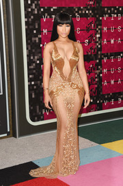 Nicki Minaj was a gold-clad bombshell at the MTV VMAs in this sheer, cleavage-boasting gown by Labourjoisie.