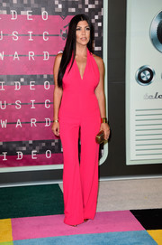 Kourtney Kardashian brought a vibrant pop to the MTV VMAs with this hot-pink Balmain jumpsuit.